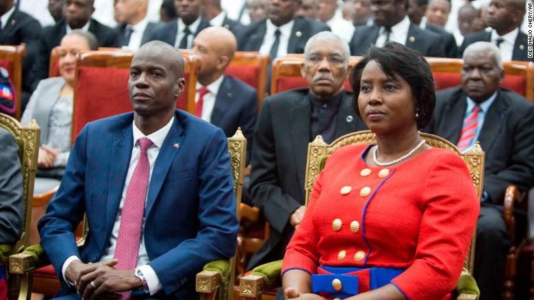 Moise sits with his wife, Martine, during his swearing-in ceremony in Port-au-Prince, Haiti, on February 7, 2017.
