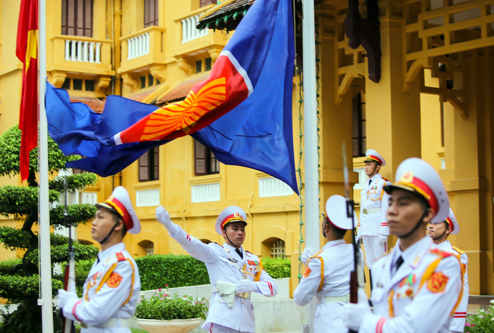 asean flag hoisting ceremony in hanoi marks the 53rd founding anniversary
