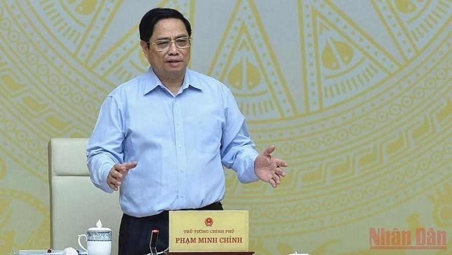 Prime Minister Pham Minh Chinh speaking at the meeting. (Photo: TRAN HAI/NDO)