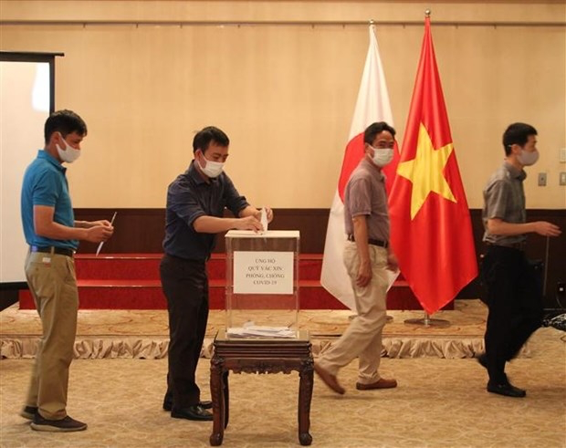 Overseas Vietnamese in Japan, Laos support Covid-19 vaccine fund