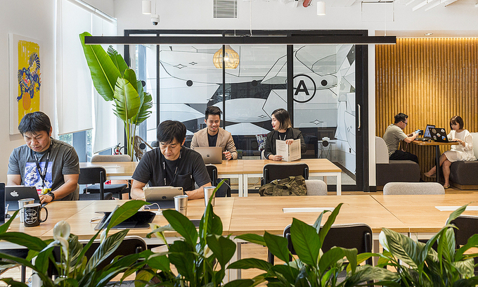 Staff work at a coworking space in HCMC's District 1. Photo: VnExpress
