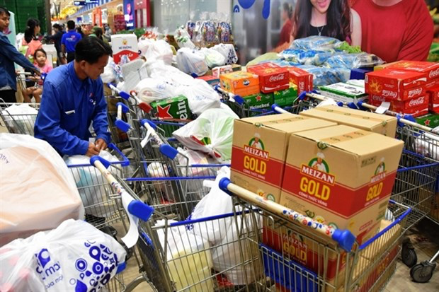 An employee from a supermarket in HCM City delivers goods to customers. (Photo congthuong.vn)