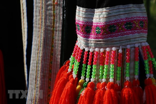 Unique decorative motifs and jewelry on the costumes of Red Dao women. Photo: VNA