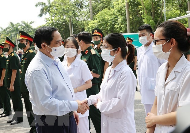 Prime Minister Pham Minh Chinh talks to health workers at the campaign launch on July 10. Photo: VNA