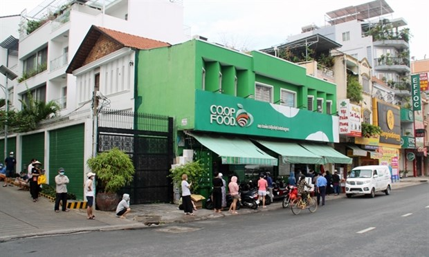 Shoppers lined up outside a supermarket in Binh Thanh district, HCM City, on July 14. Photo: VNA