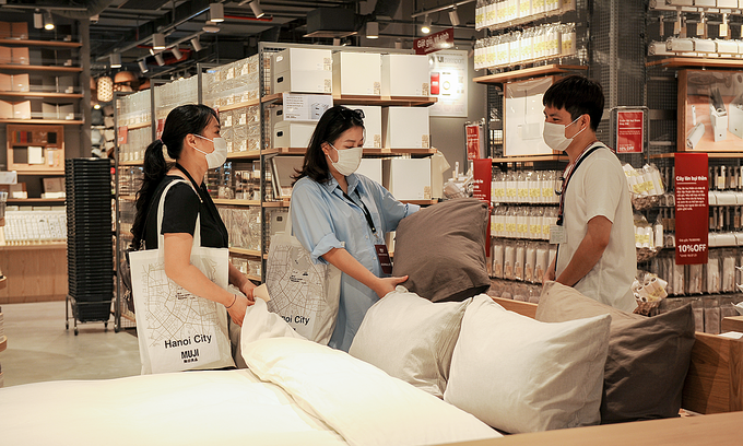 People check pillows inside Muji's first store in Hanoi. Photo: VnExpress