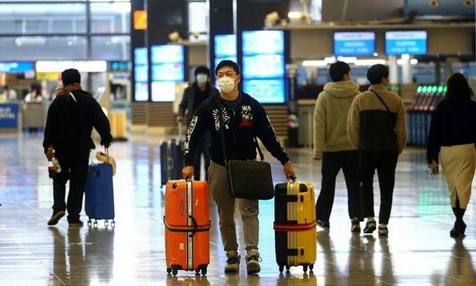 Passengers at Kansai International Airport in Osaka, Japan, 2020. Photo: Reuters