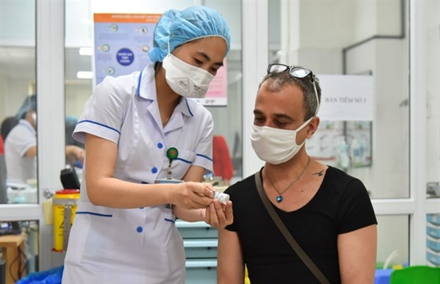 HCM City is working on a vaccination plan for foreigners. Photo: WVR