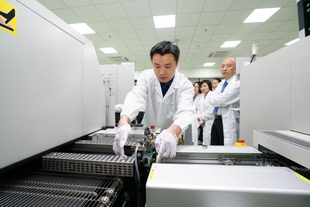 An engineer monitors a production line at a circuit board factory at the Da Nang IT Park. The central city's IZs and IPs have still lured investment in spite of the coronavirus outbreak. Photo: Trung Nam Group