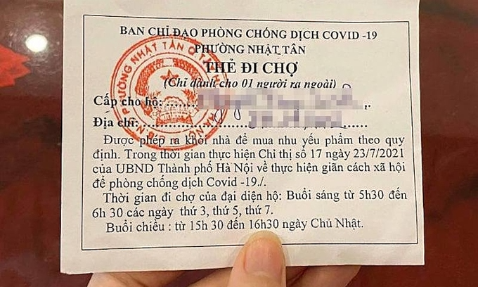 A sample food stamp being issued to residents of Hanoi's Nhat Tan Ward. Photo: VnExpress
