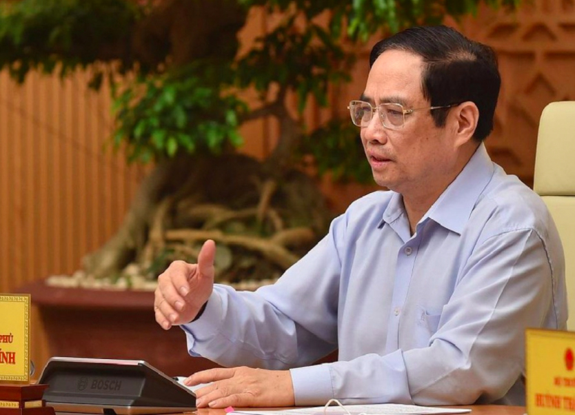 PM Pham Minh Chinh says a greater effort should be made to speed up vaccine research and development so that the first locally produced COVID-19 vaccine is likely to be marketed in September. Photo:VGP