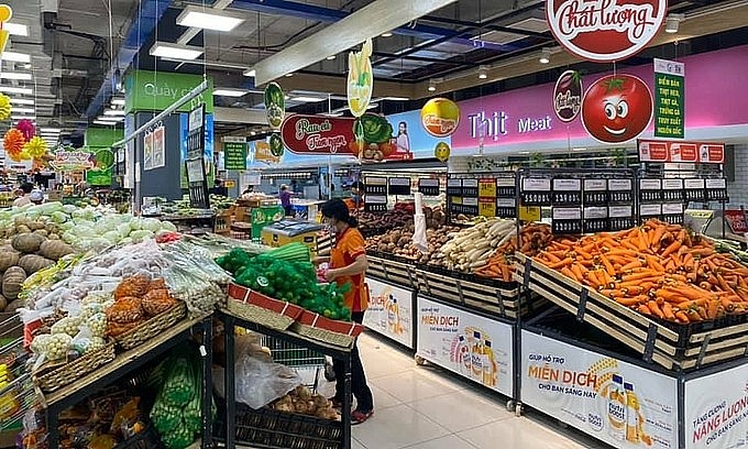 Well stocked vegetable shelves at a supermarket in HCMC. Photo: VnExpress