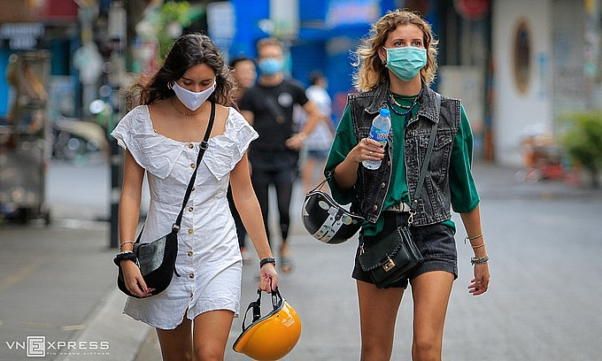 Foreign tourists walk on Bui Vien backpacker street in downtown HCMC, March 2020. Photo: VnExpress
