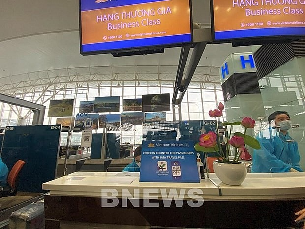 A checkin booth of Vietnam Airlines at an airport. Photo: VNA