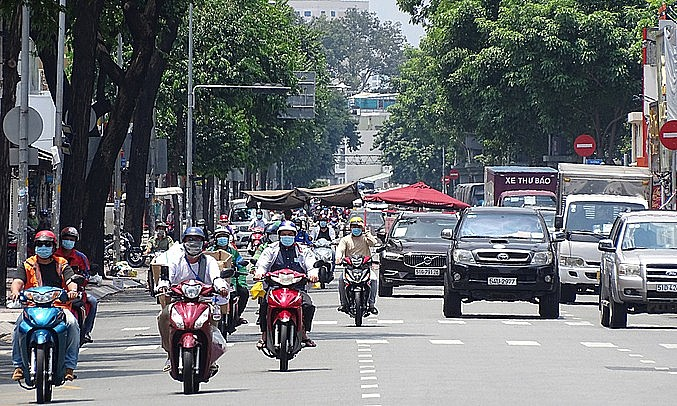 People drive on Vo Thi Sau Street in District 3, HCMC, August 2021. Photo: VnExpress