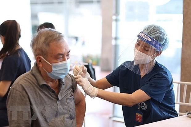 A man gets vaccinated against Covid-19 in Hanoi's Hoan Kiem district. Photo: VNA
