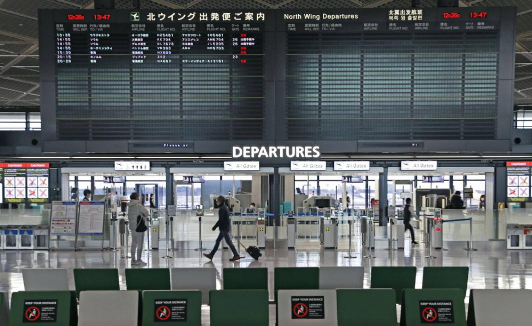 japan to halt new entry of foreign nationals over virus strain