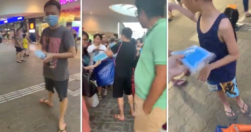 sporean man and vietnamese wife give out 17000 free masks in singapore mrt