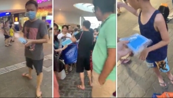 S'porean man and Vietnamese wife give out 17,000 free masks in Singapore MRT