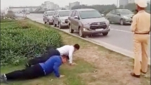 Vietnamese traffic policer fines drivers by doing push-ups for not wearing face mask