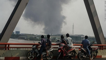 Chinese factories set on fire in Myanmar's deadliest day since coup