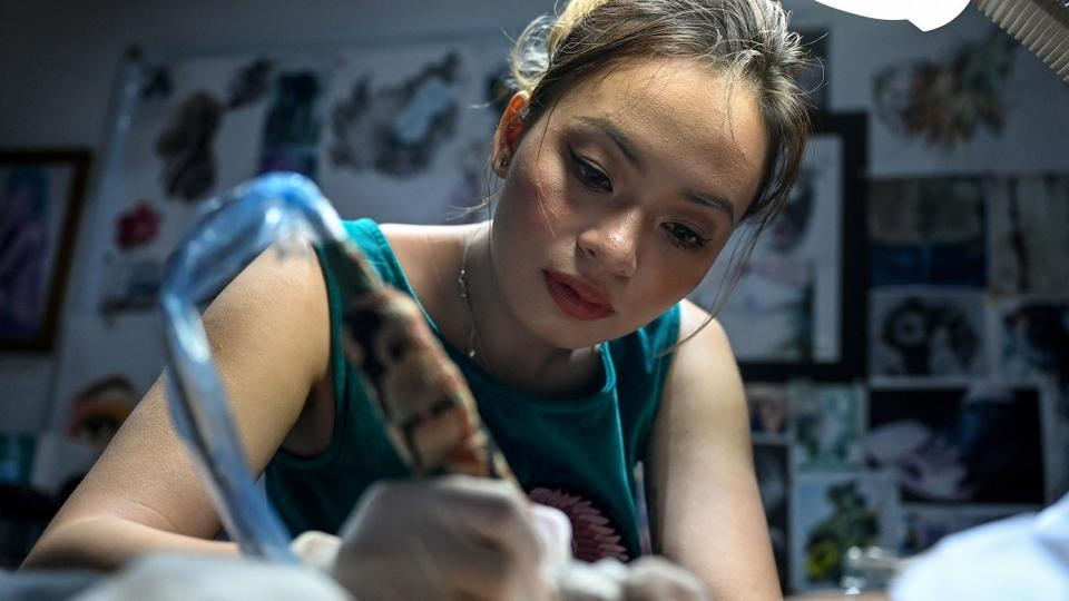 Vietnamese artist helps women cover their scars with tattoos