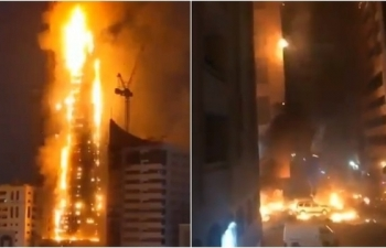 massive fire lights up residential skyscraper in uae
