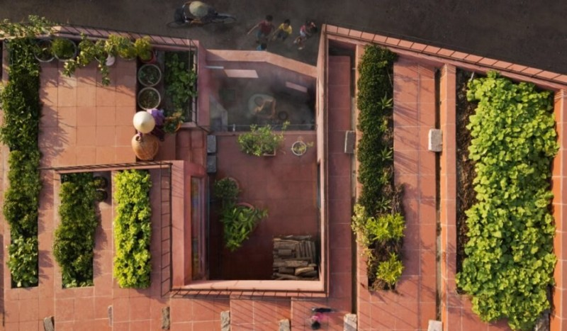 a rich vegetable garden grows atop a unique home in vietnam