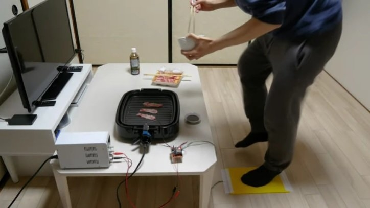 Human-powered grill that makes you work for your food