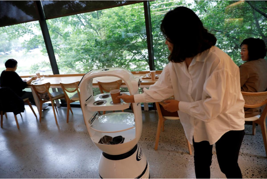 robot baristas reinforce social distancing at south korean cafe