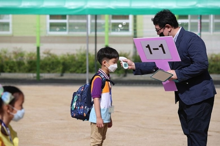 Fear of Covid-19 spikes, South Korea limits number of pupils in schools