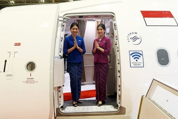 garuda indonesia crew to stop wearing face masks for service with smiles