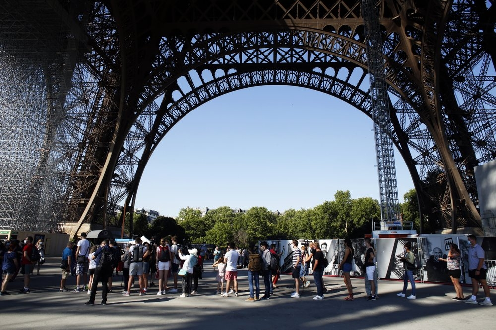 eiffel tower reopens in paris after a 3 month shutdown the longest closure since wwii