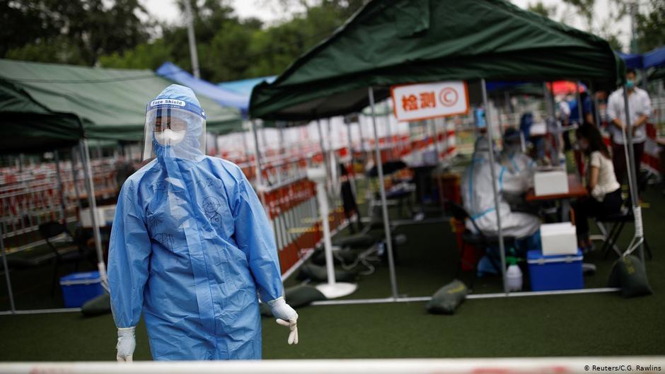China: over 500,000 people in lockdown as coronavirus cases rise again in Beijing