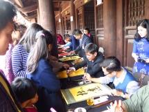 hanoi residents seek calligraphy letters for tet good lucks