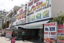 foreign languages dominate shop signs in da nang