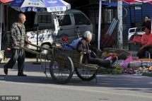touching chinese 64 yr old man taking care of his 80 yr old mom