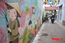 Mural paintings stir quiet valley in Da Nang