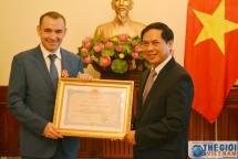 friendship medal presented to former french ambassador