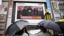 millions around the world watch in awe as historic trump kim summit unfolds