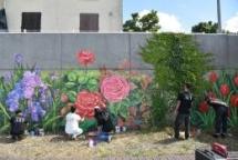 vietnamese artists decorate dyke wall along seine river bank