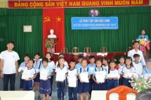 copi presents stationeries to students in vinh long