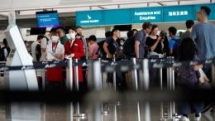 hong kong airport reopens despite flights cancelled after protesters leave
