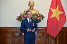 first class labour order presented to outgoing lao ambassador