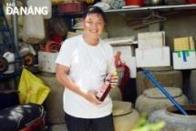 Men devoted to preserving tradition craft of Nam O fish sauce making