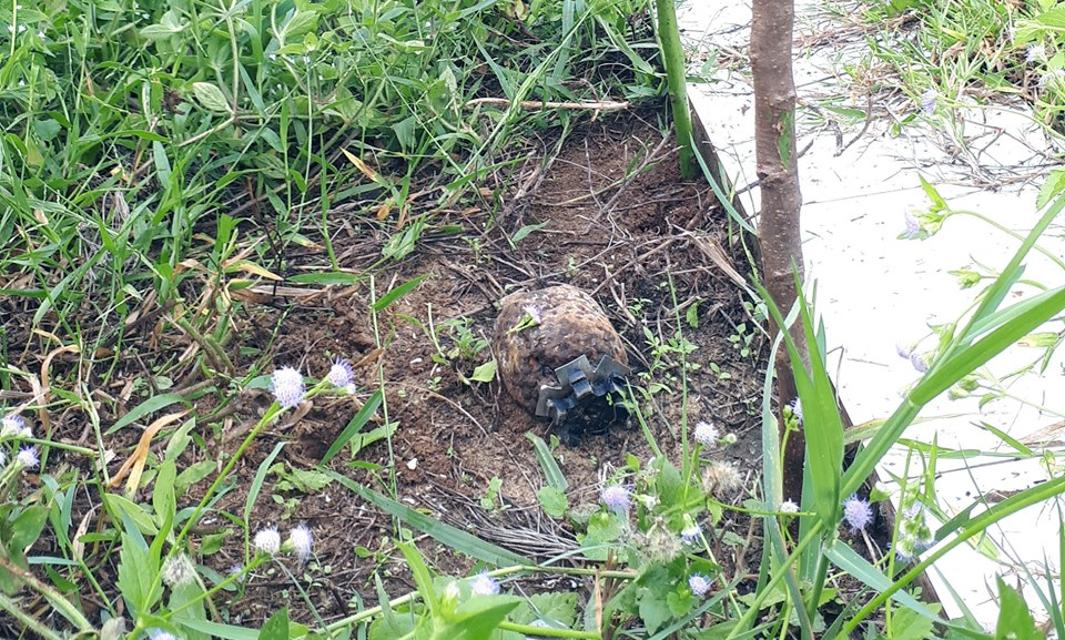 Cluster bomb, in Quang Tri's school football field, safely destroyed