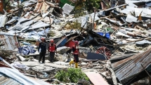 indonesia quake death toll nears 2000 as more bodies are found