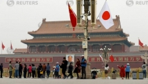japan pm abe welcomed near tiananmen square in rare china visit