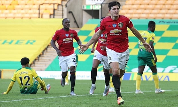 Harry Maguire celebrates scoring of Manchester United's second and decisive goal in their FA Cup quarter-final at Norwich. Photograph: Matthew Peters/Manchester United/Getty Images